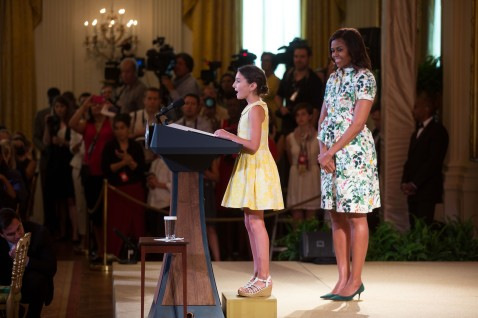 Abby Cornwell, 2014 KidsÕ State Dinner winner from Ohio, introduces First Lady Michelle Obama during the Kids' State Dinner in the East Room of the White House, July 10, 2015. (Official White House Photo by Lawrence Jackson) This photograph is provided by THE WHITE HOUSE as a courtesy and may be printed by the subject(s) in the photograph for personal use only. The photograph may not be manipulated in any way and may not otherwise be reproduced, disseminated or broadcast, without the written permission of the White House Photo Office. This photograph may not be used in any commercial or political materials, advertisements, emails, products, promotions that in any way suggests approval or endorsement of the President, the First Family, or the White House.